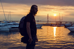 Guy with long hair in silhouette standing on the beach Royalty Free Stock Photos