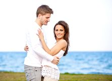 Guy Looking Affectionately at His Girlfriend Royalty Free Stock Images