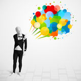 Guy looking at colorful speech bubbles Stock Photos