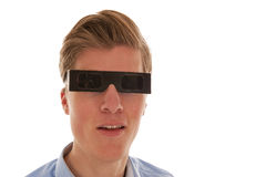 Guy looking through eclipse glasses Royalty Free Stock Photos