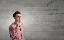 Guy looking in magnifying glass royalty free stock photos