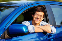 Guy looking out through open car window Royalty Free Stock Images
