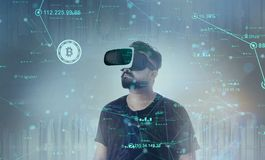 Free Guy Looking Through VR Virtual Reality Glasses - Bitcoin Royalty Free Stock Photography - 108195617