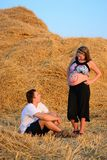 Guy looks at the belly of a pregnant woman with her mouth open Stock Images