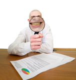 Guy looks through the big magnifier Royalty Free Stock Images