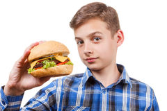 Guy looks at the burger and was going to eat it Royalty Free Stock Photos