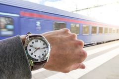 A guy looks at his watch and miss the train stock photos