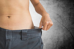 Guy loose their weight, healthy diet lifestyle, with concrete texture background Stock Photography