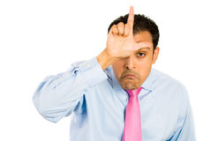 Guy with loser sign on forehead Royalty Free Stock Photography