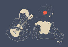Guy in love playing the guitar for his girlfriend Royalty Free Stock Images