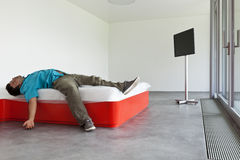 Guy lying on the bed Stock Photos