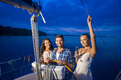Guy made a trip for the girls on the yacht. Stock Images