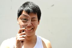 Guy with magnifying glass Royalty Free Stock Photos