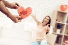 Guy Makes A Gift To Girlfriend On Valentine`s Day. royalty free stock image