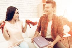 Guy Makes A Gift To Girlfriend On Valentine`s Day. royalty free stock photography