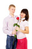 The guy makes a proposal to the girl with the rose Royalty Free Stock Photography