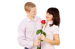 The guy makes a proposal to the girl with the rose Stock Photos