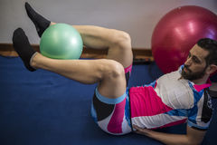 Guy making fitness. In a fitness center Stock Image