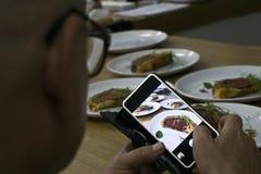 Guy making food shots Stock Photography