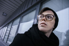 Young man in glasses and black coat , outdoor Stock Photo