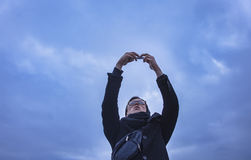 Young man making selfie on smartphone, outdoor Stock Photos