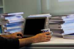 Guy or man or student or businessman work on a laptop computer i Stock Photography