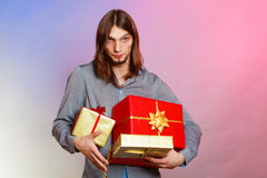 Guy with many presents gift boxes Stock Photo