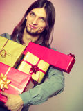 Guy with many presents gift boxes Royalty Free Stock Photos