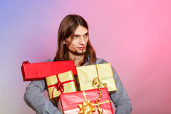 Guy with many presents gift boxes Royalty Free Stock Photo