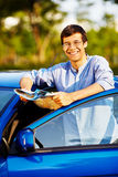 Guy with map near car Stock Image