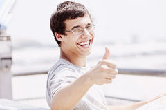 Guy with map showing thumb up Royalty Free Stock Photography