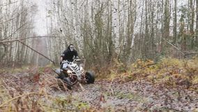 The guy with the mask on her face riding her ATV stock footage