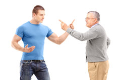 A guy and mature man arguing Stock Image