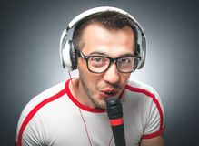 Guy with microphone and headphones Stock Image