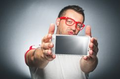 Guy with mobile phone Royalty Free Stock Photo