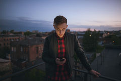 Guy with mobile phone on sky backdrop Stock Photo