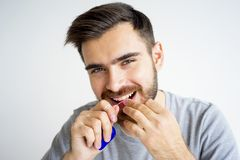 Guy morning hygiene. Morning hygiene routine of a guy shaving brushing and flossing teeth Royalty Free Stock Image