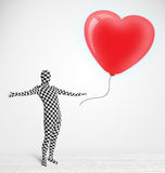 Guy in morpsuit body suit looking at a red balloon shaped heart Royalty Free Stock Photo