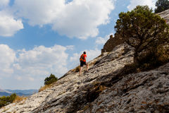 Guy on mountain in summer Royalty Free Stock Photo
