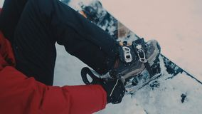 Guy in the mountains snowboarding clothes stock video footage