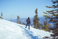 The guy is in the mountains in the winter Royalty Free Stock Photo