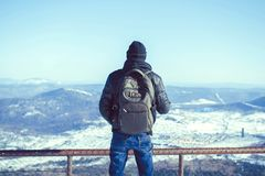 The guy is in the mountains in the winter Stock Photo