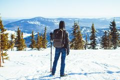 The guy is in the mountains in the winter Stock Photos