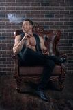 The guy with the muscles smokes. Royalty Free Stock Photography