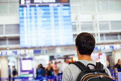 Guy near airline schedule Stock Images