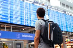 Guy near airline schedule Royalty Free Stock Photo