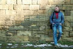 The guy near a brick wall Royalty Free Stock Photo