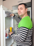 Guy near opened refrigerator royalty free stock images