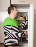 Guy   near  refrigerator  at home Stock Image