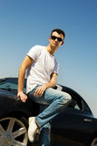Guy near the sport car stock photography